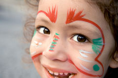 Little Girl With Face Paint Looking Up Royalty Free Stock Images