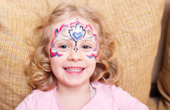 Little girl with face painting Stock Images
