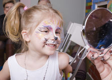 Little girl with faceart on birthday party Stock Photography