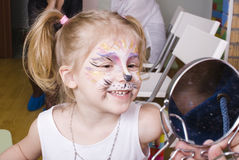 Little girl with faceart on birthday party Royalty Free Stock Image