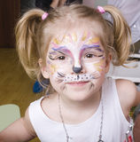 Little girl with faceart on birthday party Royalty Free Stock Photos