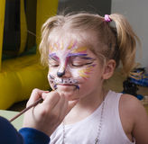 Little girl with faceart on birthday party Stock Image
