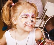 Little girl with faceart on birthday party in Royalty Free Stock Photography