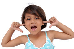 Little girl facial expression. Little girl  shouting putting fingers in ears Royalty Free Stock Image