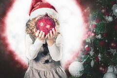 Little girl fairy blowing fairy magical ball, stardust at Christmas Stock Images