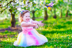 Little girl in fairy costume feeding a bird Stock Photography