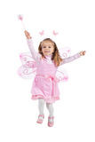 Little girl in fairy costume jump