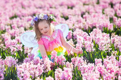 Little girl in fairy costume playing in flower field Royalty Free Stock Photography