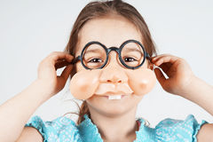Little girl with fake nose glasses Royalty Free Stock Photos