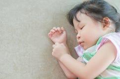 Little girl fall asleep on the floor. Little asian girl fall asleep on the floor Stock Photos