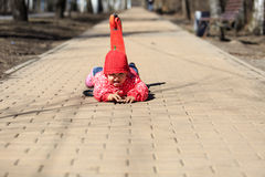 Little girl fall off of scooter Royalty Free Stock Image