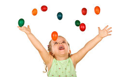 Little girl with falling easter eggs Royalty Free Stock Photo