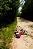 Little girl falling off her bicycle Royalty Free Stock Photography
