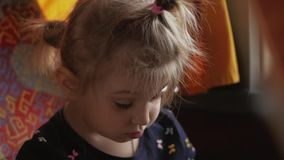 A little girl falls asleep on the seat of the bus. Cute baby falls into a dream stock video