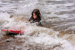 Little Girl Falls Off Boogie Board Shallow Water Breaking Wave Royalty Free Stock Photos