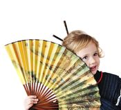 Little girl with fan Stock Photo