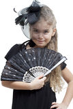 Little girl with a fan Royalty Free Stock Image