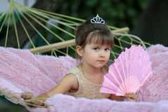 The little girl with a fan Stock Photo