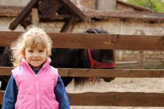 Little girl on the farm Royalty Free Stock Photo