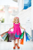 Little girl fashion with packages at the Mall Stock Photo