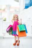 Little girl fashion with packages at the Mall Stock Images