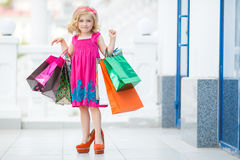 Little girl fashion with packages at the Mall Royalty Free Stock Photography
