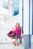Little girl fashion with packages at the Mall Royalty Free Stock Photos