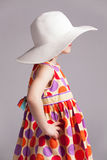 Little girl in a fashionable hat Royalty Free Stock Photo