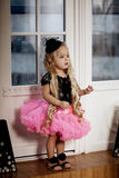 Little girl in a fashionable luxury interior Stock Photos