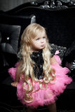 Little girl in a fashionable luxury interior stock photography