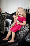 Little girl in a fashionable luxury interior Stock Image