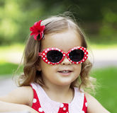 Little girl in fashionable sunglasses Royalty Free Stock Image
