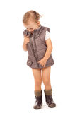 Little girl in a fashionable vest and boots Royalty Free Stock Photography