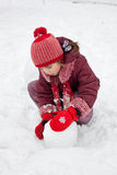 The little girl fashions snowman  Stock Photography