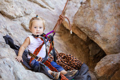Little girl fastened to rock climbing gear Royalty Free Stock Image