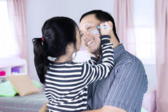 Little girl with father in the bedroom Royalty Free Stock Image