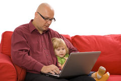 Little girl with father on the computer Royalty Free Stock Image