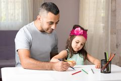 Little Girl And Father Drawing Pictures Together Royalty Free Stock Photo