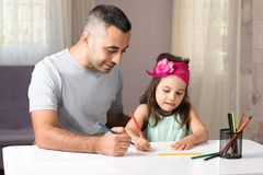 Little Girl And Father Drawing Pictures Together Royalty Free Stock Images