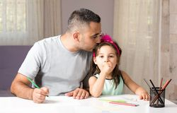Little Girl And Father Drawing Pictures Together Royalty Free Stock Photos