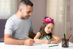 Little Girl And Father Drawing Pictures Together Stock Photos