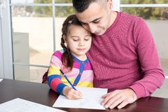 Little Girl And Father Drawing Pictures Together Royalty Free Stock Image