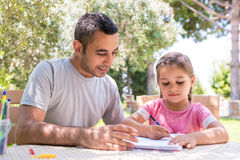 Little Girl And Father Drawing Pictures Together Outdoors In Sum. Mer Royalty Free Stock Images