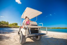 Little girl with father golf cart on tropical Stock Image