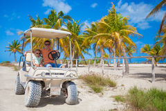Little girl with father golf cart on tropical Royalty Free Stock Photo