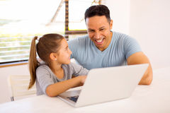 Little girl father laptop Stock Images