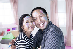 Little girl and father laughing together Stock Photos