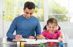 Little Girl And Father Painting Pictures Together Stock Photos