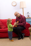 Little girl with father play electric guitar Stock Image