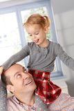 Little girl and father playing together Royalty Free Stock Photography